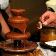 unforgettable weddings, unconventional weddings, wedding theme ideas, chocolate fountains, cheese sclupture, chair bows
